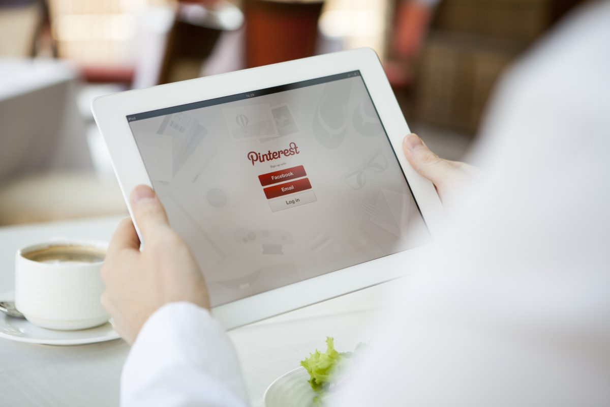 home builders Pinterest marketing plan Moscow, Russia - August 9, 2013: Man hands holding iPad with Pinterest app. Pinterest is a pinboard-style photo sharing website that allows users to create and manage theme-based image collections such as events, interests, hobbies, and more.