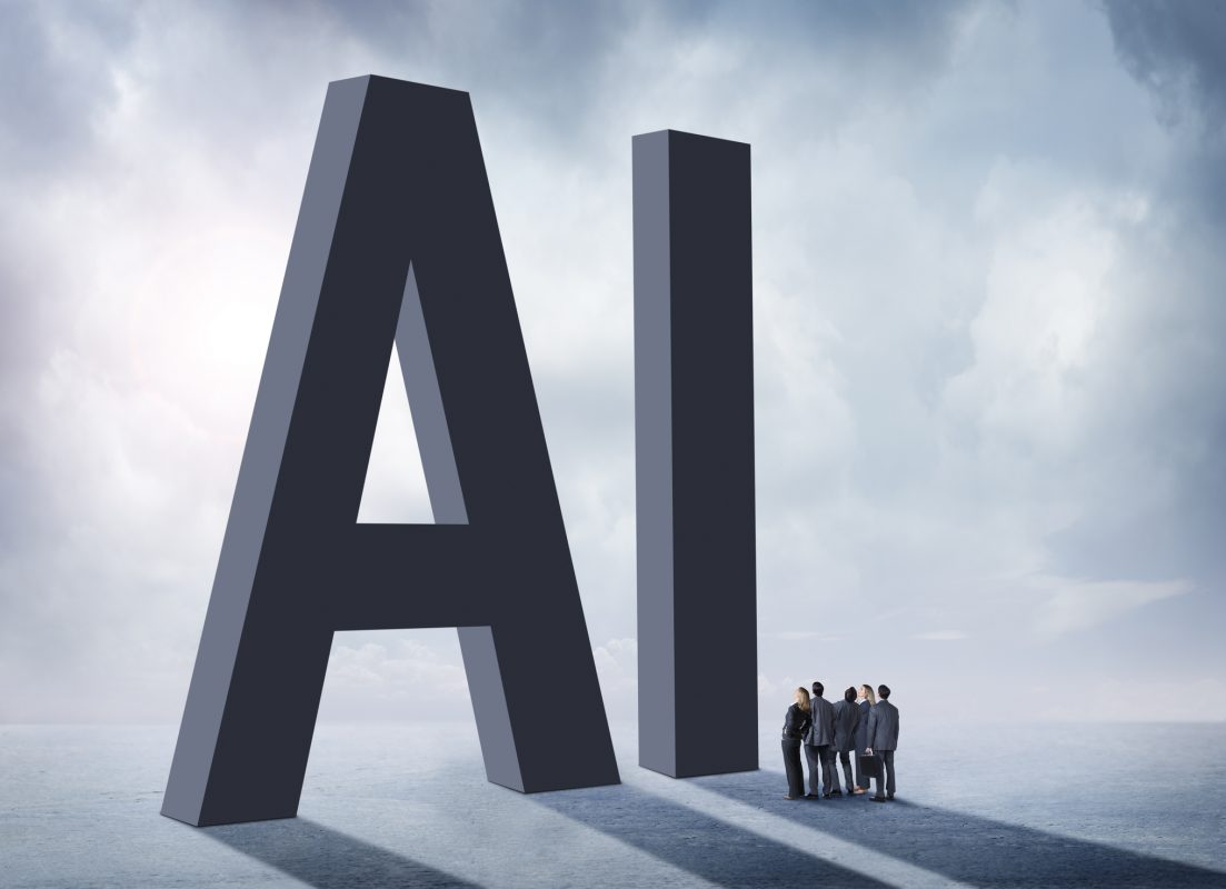 "Artificial Intelligence myths - A group of businesspeople stand in the shadow of the large letters, ""AI"" which stand for artificial intelligence. They are concerned and unsure about the unknown implications of the rollout of artificial intelligence on our society."