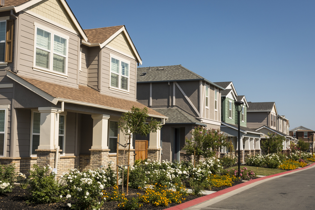 single-family homebuyer -A row of newly-built houses in a residential subdivision.