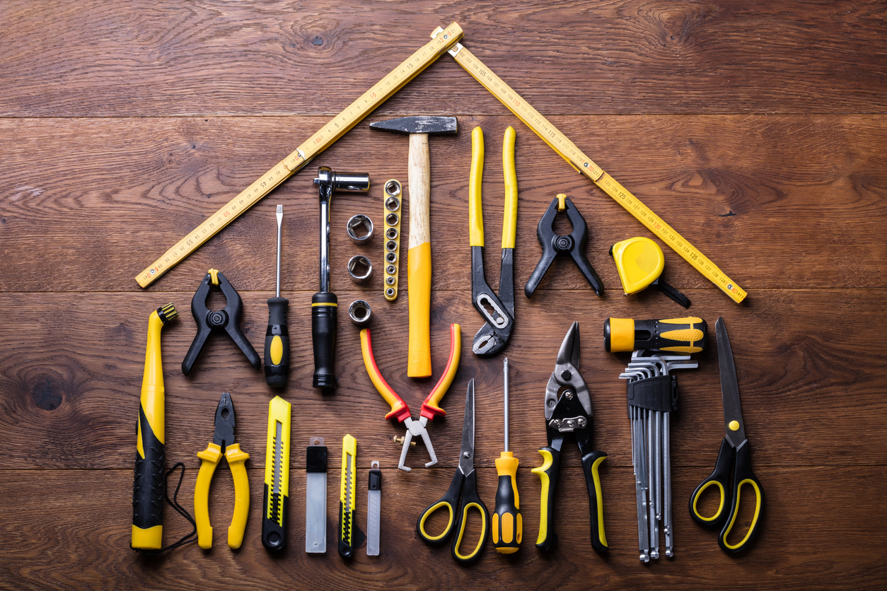 representing online resources - Elevated View Of Many Tools With Roof Made With Yellow Measuring Tape On Wooden Table