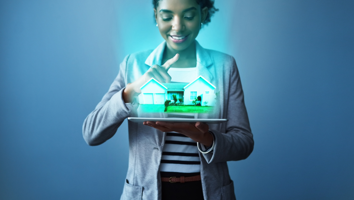 renderings - Studio shot of a young businesswoman using a digital tablet with property graphics against a blue background