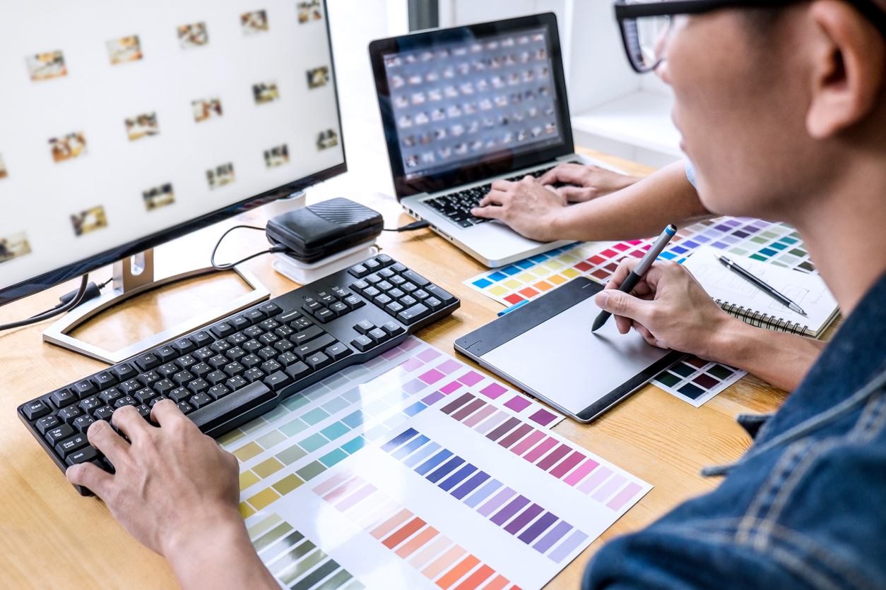 3D modeling - Team of young colleagues creative graphic designer working on color selection and drawing on graphics tablet at workplace, Color swatch samples chart for selection coloring.