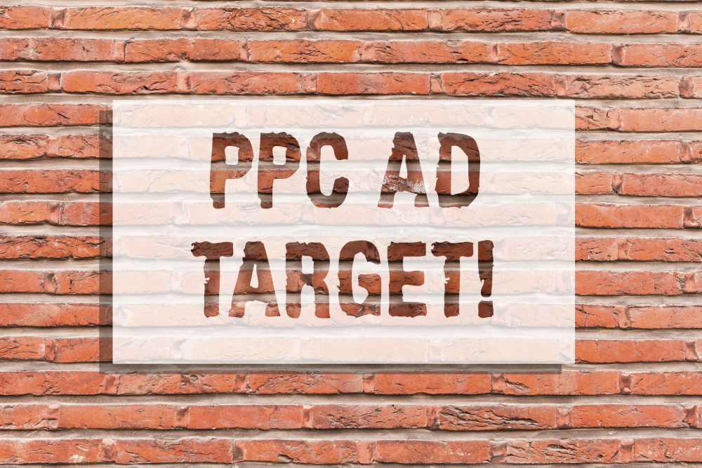 Text sign showing Ppc Ad Target. Conceptual photo Pay per click advertising marketing strategies online campaign Brick Wall art like Graffiti motivational call written on the wall.